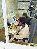 Two people taking orders and dispatching drivers